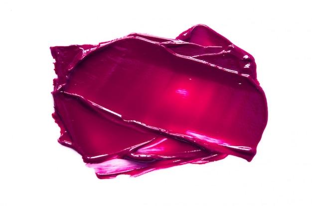 Geïsoleerde vlek en textuur van purpere lippenstift of olieverf.