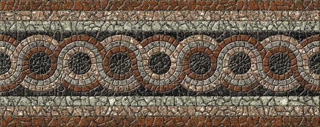 Gekleurd reliëfmozaïek gemaakt van natuursteen. achtergrond textuur. geplaveide tegels