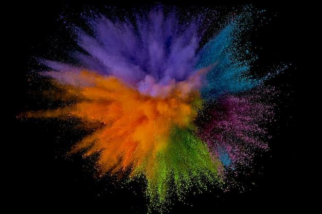 Gekleurde poederexplosie. abstract close-upstof op achtergrond. kleurrijk exploderen. verf holi