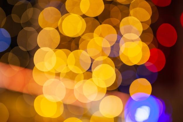 Gekleurde samenvatting vage lichtenachtergrond, de dag van conceptenkerstmis