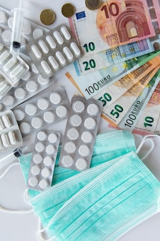 Geld, pil en ademhalingsmaskers