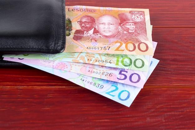 Geld uit lesotho in de zwarte portefeuille