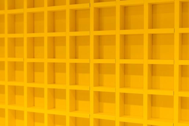 Gele 3d-muur met repetitief patroon