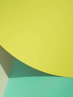 Gele abstracte papier vormen met schaduw