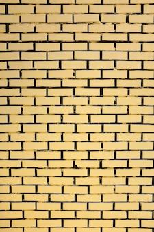 Gele bakstenen muurachtergrond