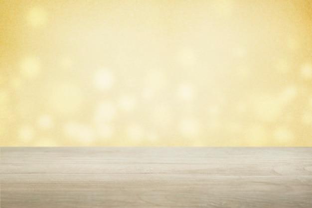Gele bokehmuur met beige vloerproductachtergrond