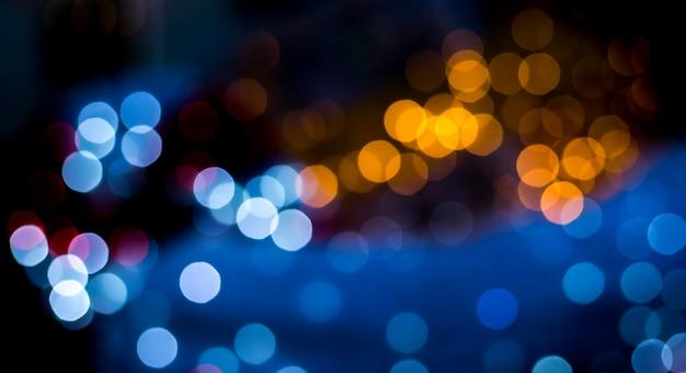 Gele en blauwe bokehlichten