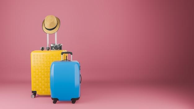 Gele en blauwe koffer met zonnehoed en brilcamera op pastelroze