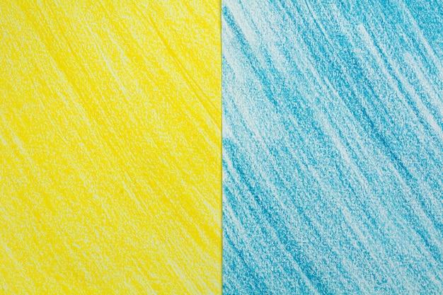 Gele en blauwe lijn krijt tekening schets op wit papier achtergrond.