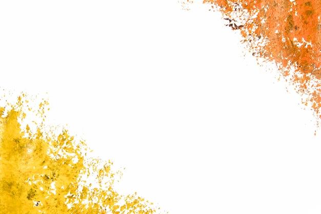 Gele en oranje verf op wit