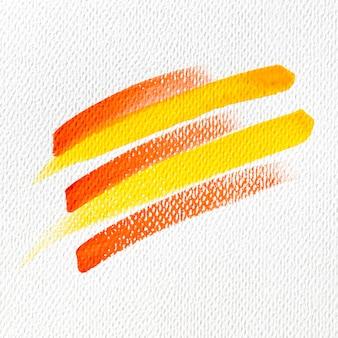 Gele en rode verfvlekken op canvas