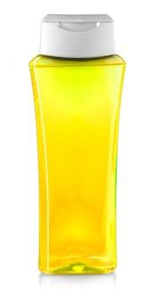 Gele fles douchegel geïsoleerd op een witte achtergrond