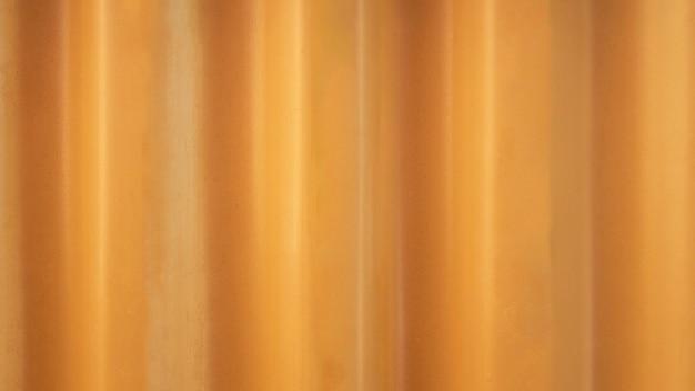 Gele gegolfde metalen textuur