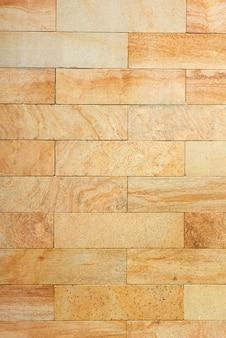 Gele het patroonachtergrond van steenbakstenen