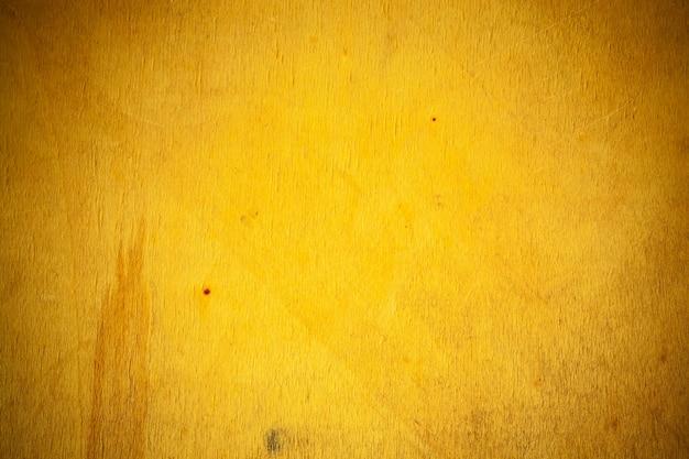 Gele houten plank achtergrond.