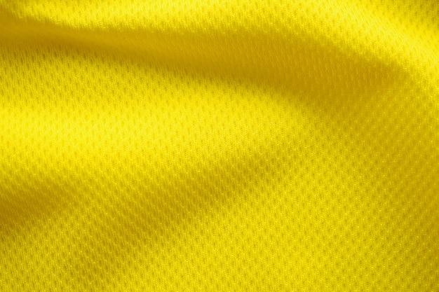 Gele kleur voetbal trui kleding stof textuur sport slijtage achtergrond, close-up