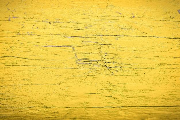 Gele oude houten achtergrond. geel geverfd hout.