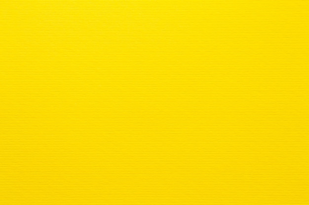 Gele pastel papier achtergrond, kleurrijke papier textuur