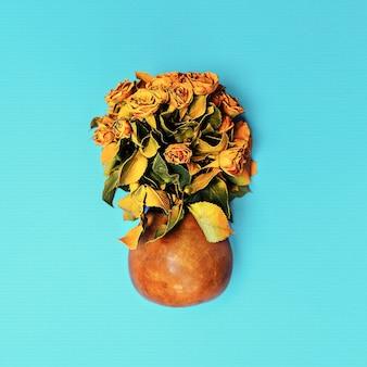 Gele rozen in pot. minimalisme kunst.