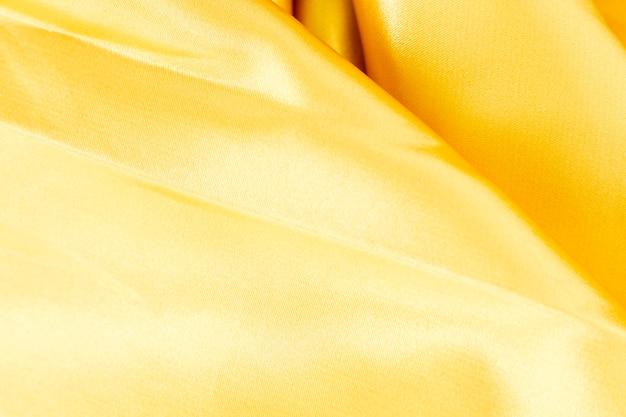 Gele stoffen materiële textuur met exemplaarruimte
