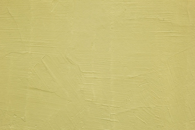 Gele textuur van de muren. heldere warme gele muur achtergrond. een oude gepleisterde muur.