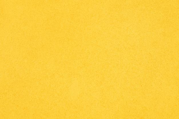 Gele textuurachtergrond met exemplaarruimte voor tekst