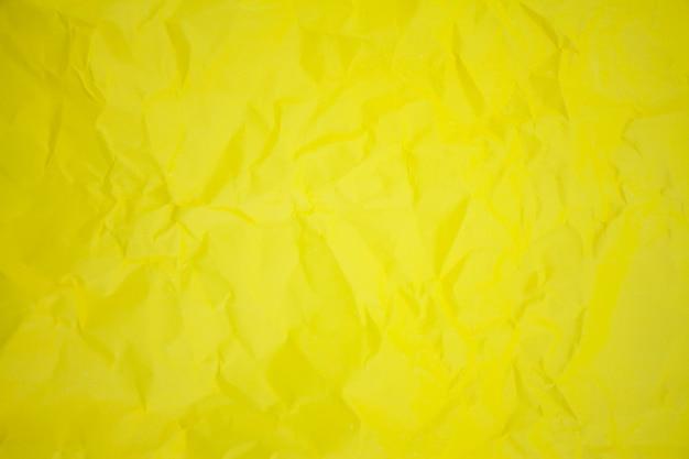 Gele verfrommeld papier achtergrondstructuur