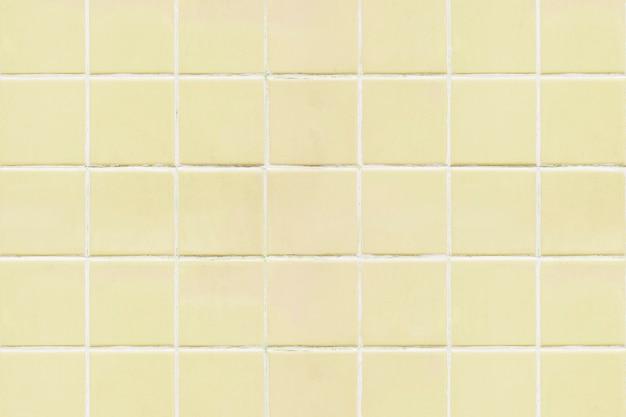 Gele vierkante betegelde textuurachtergrond