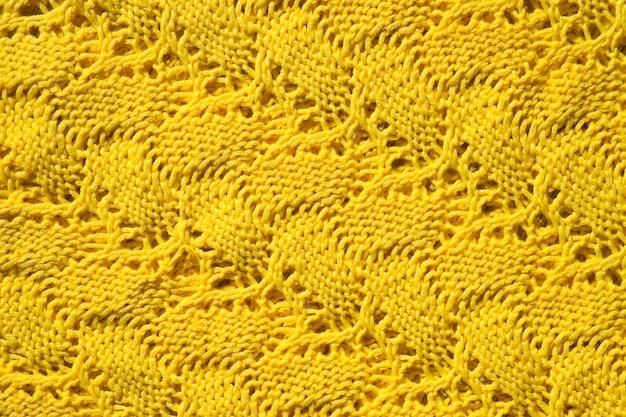 Gele woltextuur als stof en textielachtergrond gebreide wollen stof abstract patroon