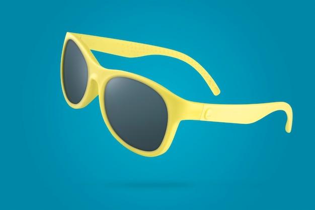 Gele zonnebril voor een zonnige zomerdag op blauw