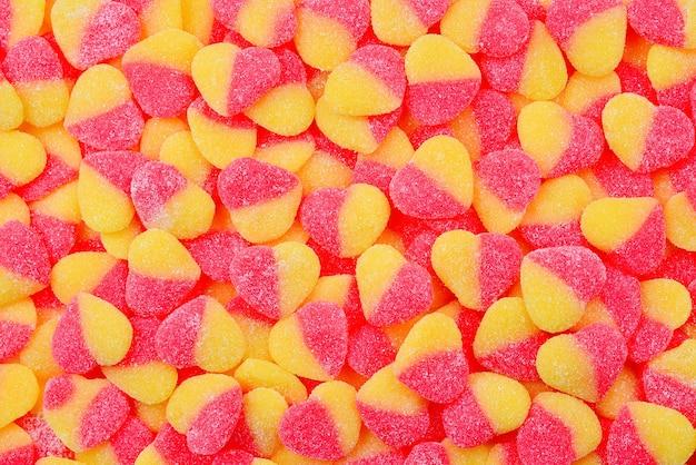 Gelei kleurrijke snoep achtergrond. snoep harten.
