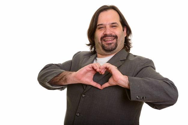 Gelukkig dikke blanke zakenman lachend hand hart teken geïsoleerd op wit
