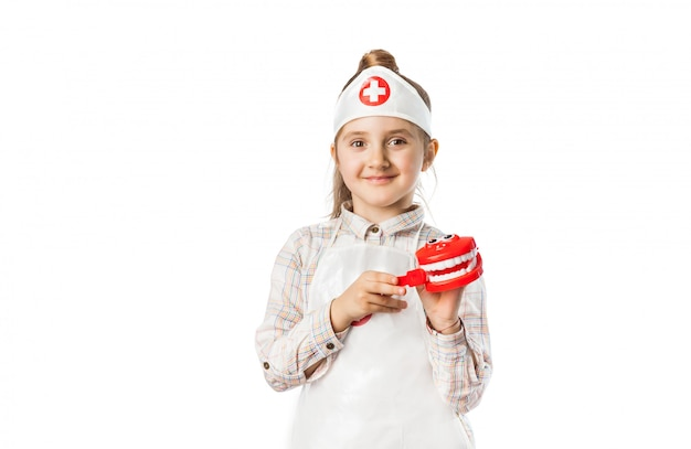 Gelukkig glimlachend babymeisje met tandartshulpmiddel