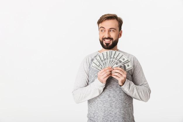 Gelukkig jonge man met geld