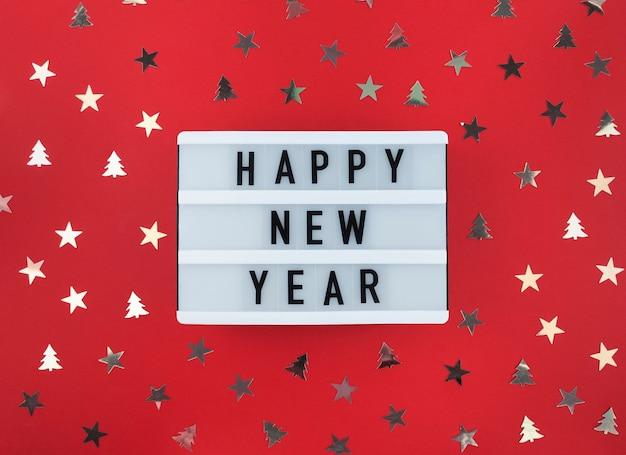 Gelukkig nieuwjaarsgroet op lightbox en confetti