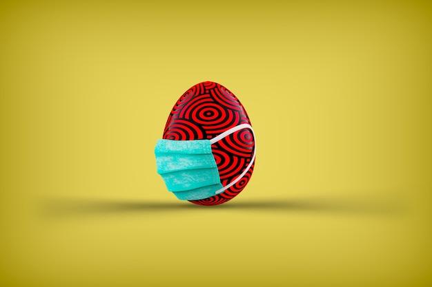 Gelukkig pasen. kleur paasei in medisch gezichtsmasker. pasen in pandemie