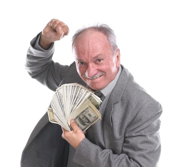 Gelukkig senior zakenman met geld geïsoleerd