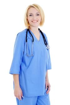 Gelukkig vrouwelijke medische student in blauw uniform - geïsoleerd op wit