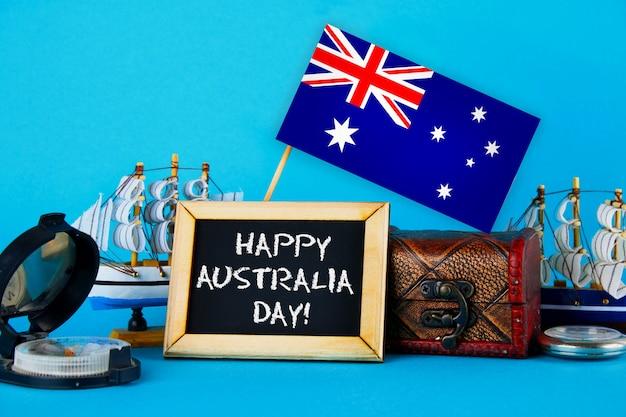 Gelukkige dag australië omringde scheepsbouwers, kompas, klok en australische vlag