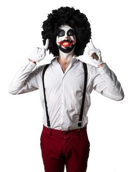 Gelukkige moordenaar clown met mes