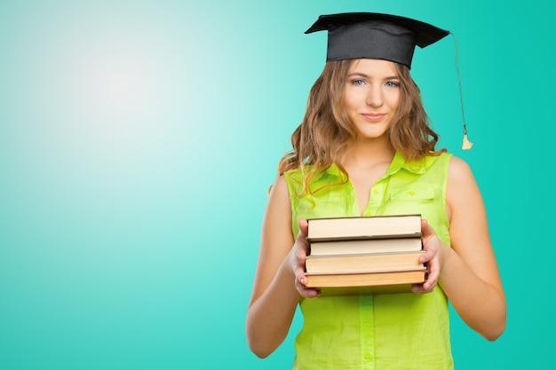 Gelukkige student in afstuderen cap