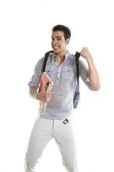 Gelukkige studentensprong met in hand universiteitsmateriaal