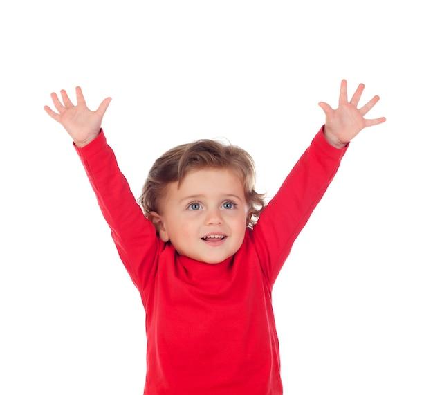 Gelukkige succesbaby die zijn handen opheft