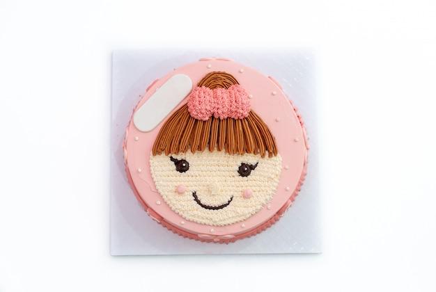 Gelukkige verjaardagscake met meisje op hoogste cake