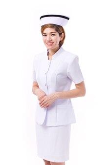 Gelukkige vrouwelijke aziatische geïsoleerde verpleegster