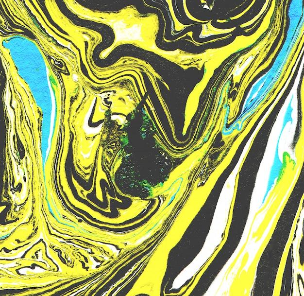 Gemarmerd papier textuur. handgemaakte achtergrond. zwarte en gele kleuren. marmeren achtergrond.