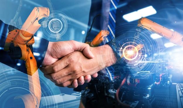 Gemechaniseerde industriële robotarm en zakelijke handdruk dubbele belichting