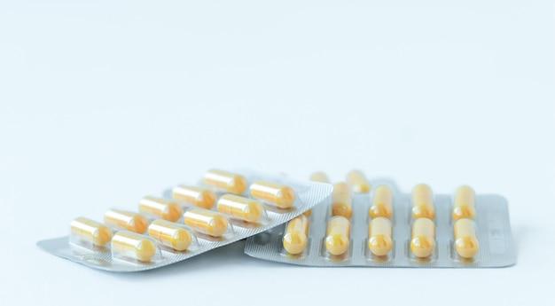 Geneeskunde achtergrond van gele capsules