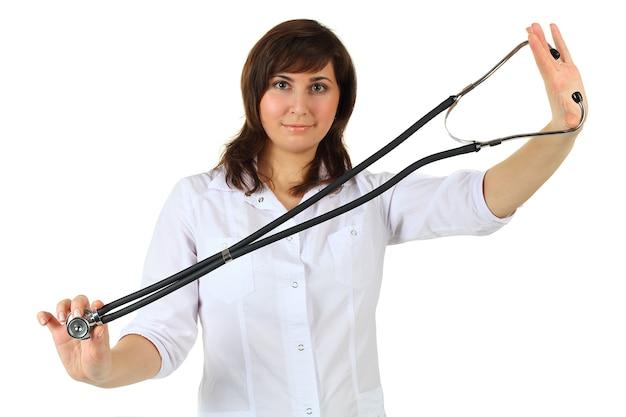 Geneeskunde concept - arts met een stethoscoop geïsoleerd op een witte achtergrond (focus op de stethoscoop)
