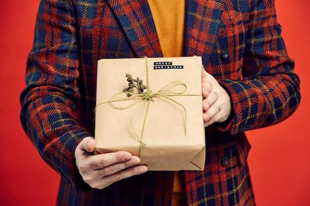 Gentleman holding christmas present